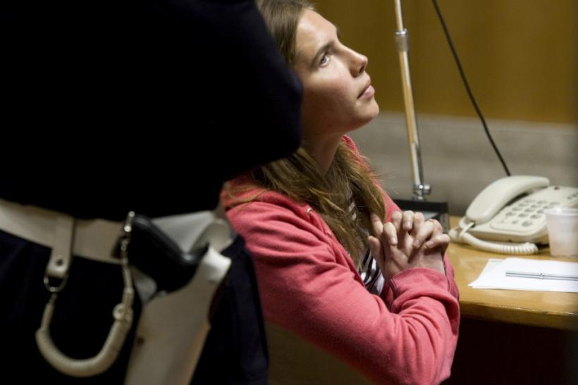 Jailed suspect Amanda Knox sits in the courtroom during a break in her murder trial session in Perugia