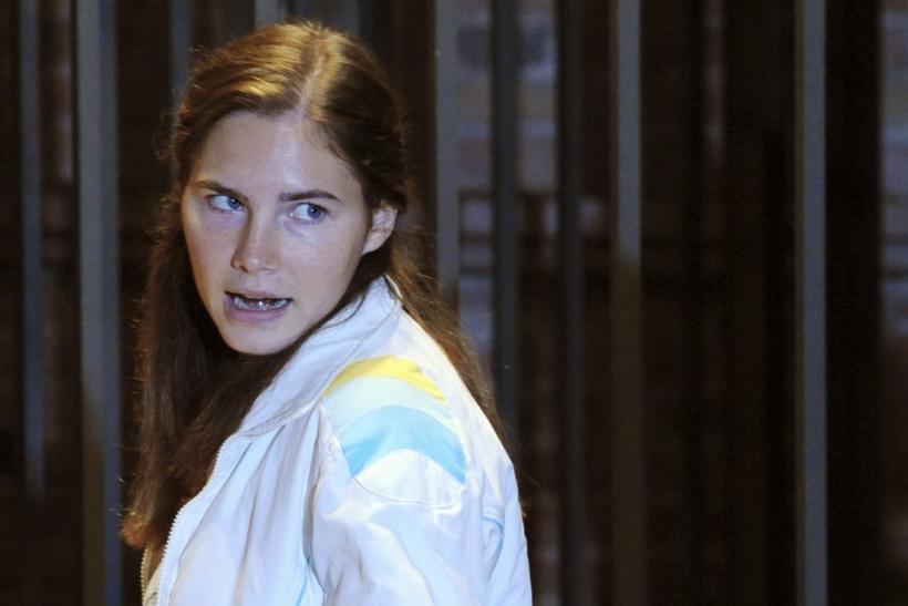 Amanda Knox reacts in the courtroom during a murder trial session in Perugia