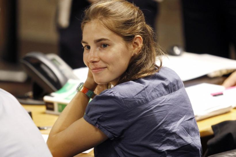 Amanda Knox, the U.S. student convicted of killing her British flatmate Meredith Kercher in Italy on November 2007, smiles during a break at her appeal trial session in Perugia