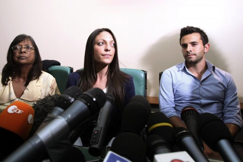 British student Meredith Kercher's family members, (from L-R) mother Arline, sister Stephanie and brother Lyle attend a news conference in Perugia
