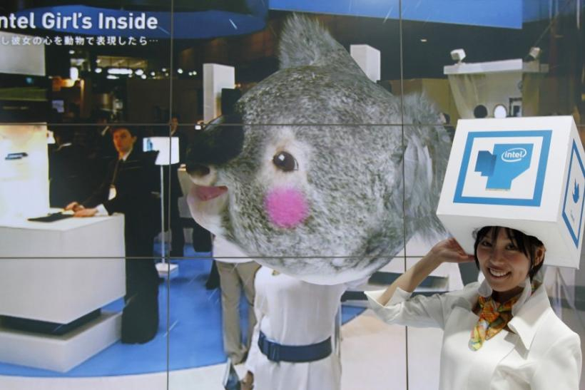 "A woman wearing a box on her head demonstrates Intel's augmented reality digital display ""Intel Girl""s inside"" at CEATEC JAPAN 2011 electronics show in Chiba, east of Tokyo"