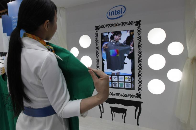 A woman demonstrates a virtual fitting system at CEATEC JAPAN 2011 electronics show in Chiba, east of Tokyo