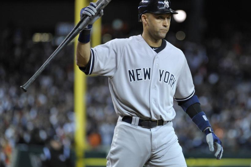 New York Yankees' Derek Jeter reacts after striking out to end the game against the Detroit Tigers catcher in Game 3 in their MLB American League Division Series baseball playoffs in Detroit