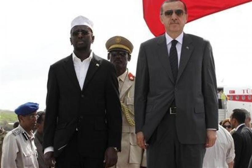 "Turkey""s Prime Minister Tayyip Erdogan (R) and Somalia""s President Sheikh Sharif Ahmed"