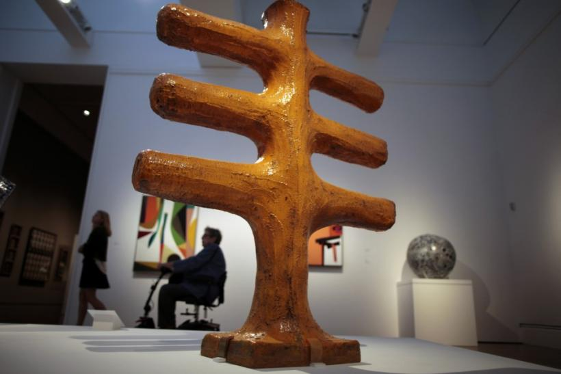 """People view """"Orange Cross"""" by John Mason at the """"Pacific Standard Time: Art in L.A. 1945-1980"""" exhibition at the Getty Center in Los Angeles, California"""