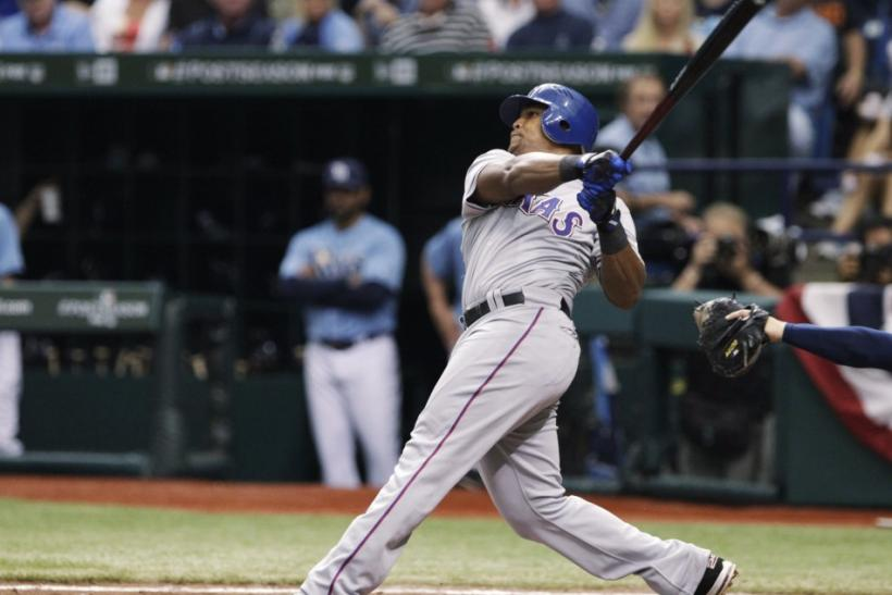 Rangers' Adrian Beltre watches his third home run of the game in the seventh inning of play against the Rays in Game 4 in their MLB playoffs in St. Petersburg