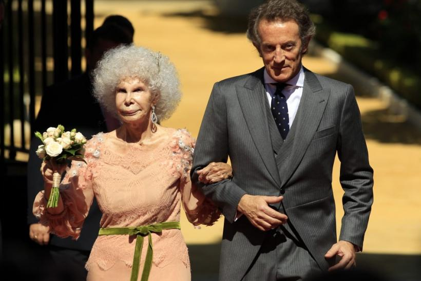 Spain's Duchess of Alba Cayetana Fitz-James Stuart y Silva and her husband Alfonso Diez pose at the enrance of Las Duenas Palace after their wedding in Seville