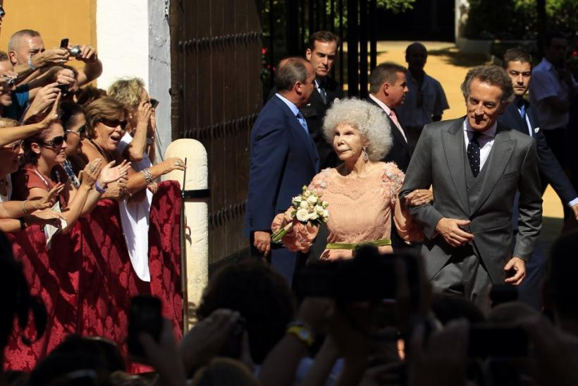 Spain's Duchess of Alba Cayetana Fitz-James Stuart y Silva and her husband Alfonso Diez pose at the enrance of Las Duenas Palace after wedding in Seville