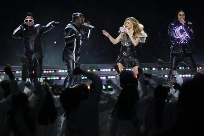 The Black Eyed Peas, apl.de.ap, will.i.am, Fergie and Taboo (L to R), perform during half-time of the NFL's Super Bowl XLV football game between the Pittsburgh Steelers and the Green Bay Packers in Arlington, Texas