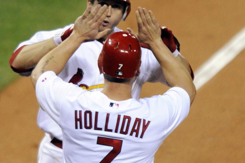 St. Louis Cardinals' Freese and Holliday celebrate after hitting a home run against Philadelphia Phillies during their MLB Divisional Series playoffs in St. Louis