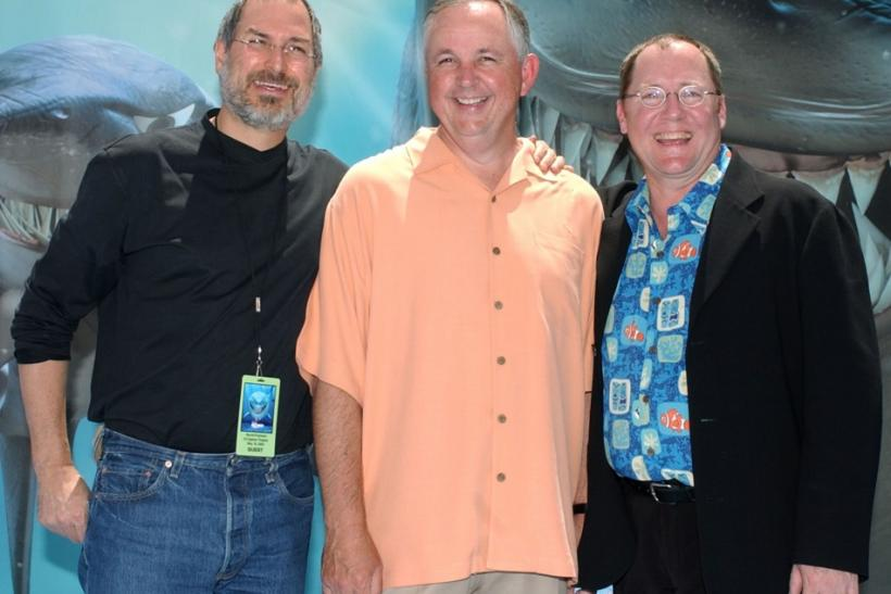 From left to right: Apple chairman Steve Jobs, Walt Disney Studios chairman Dick Cook, and executive producer John Lasseter, at Pixar's 2003 premiere of Finding Nemo.