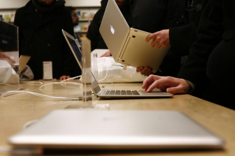 Customers try out the MacBook Air at the Apple Store in New York