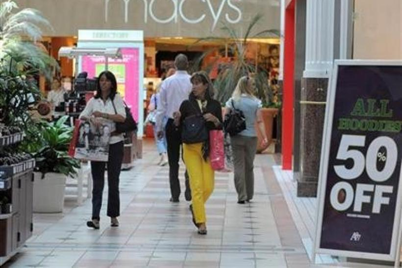 Shoppers carrying bags walk at the Pentagon City Shopping Mall in Arlington, Virginia