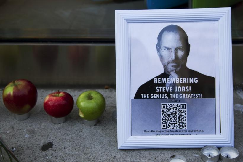 A tribute to Apple Inc., co-founder and former CEO Steve Jobs is left in front of an Apple store in downtown Montreal