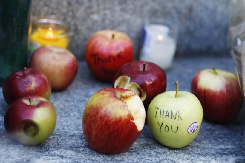 Messages left to Steve Jobs are seen written on apples at an impromptu shrine in front of Apple's flagship store on 5th Avenue in New York