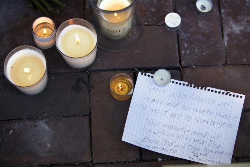 Candles are seen in front of the Apple store in Washington October 6, 2011, in memory of Steve Jobs.