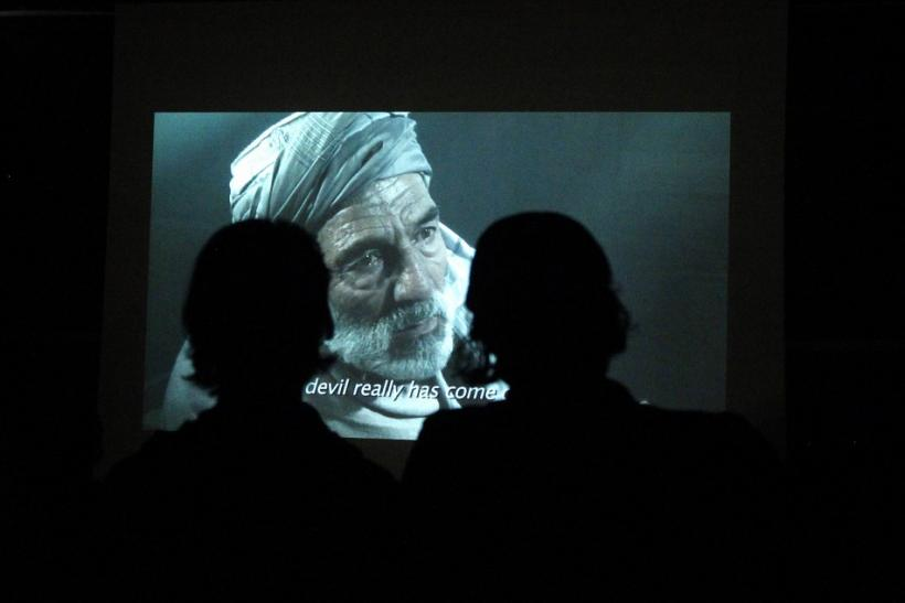 Afghans watch a movie at the French cultural center during the first Autumn Human Rights Film Festival in Kabul