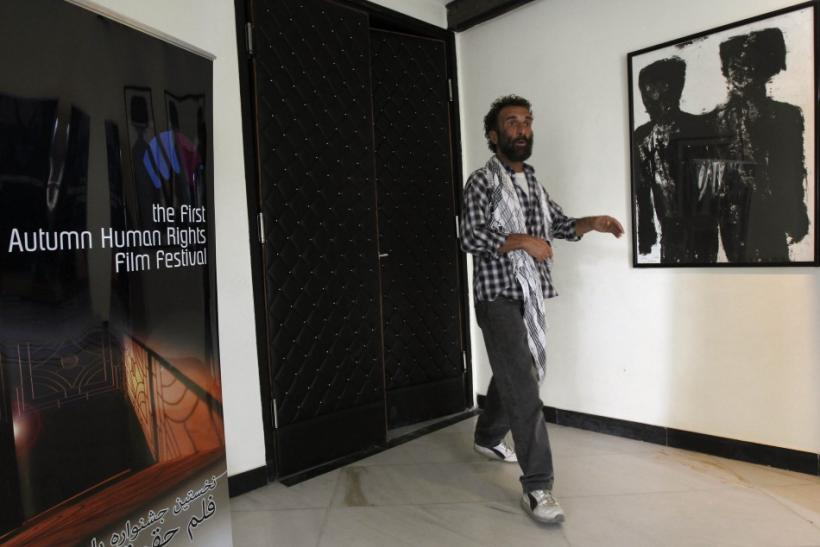 An Afghan man leaves the saloon after watching a movie at the French cultural center during the first Autumn Human Rights festival in Kabul