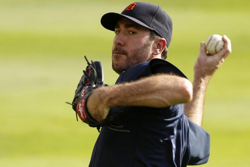 Detroit Tigers' starting pitcher Justin Verlander warms up during a practice in preparation for the MLB American League Championship Series baseball playoffs in Arlington, Texas