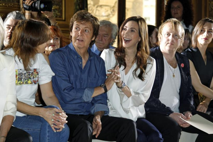 Paul McCartney (2nd L) and Nancy Shevell (3rd L) attend Stella McCartney's Spring/Summer 2012 women's collection during Paris Fashion Week