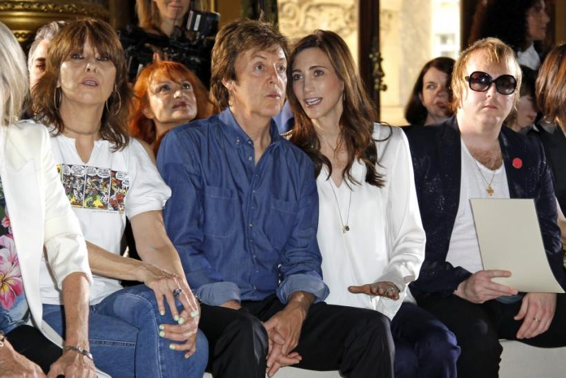 Paul McCartney and his girlfriend Nancy Shevell attend the fashion show designed by his daughter Stella McCartney at her Spring/Summer 2012 women's collection during Paris Fashion Week