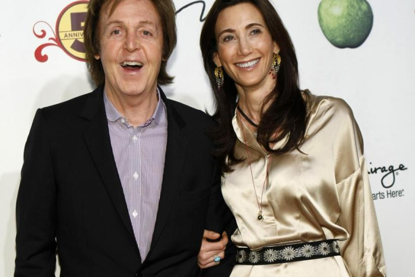 "Paul McCartney (L) and Nancy Shevell pose as they arrive for the fifth anniversary celebration of ""The Beatles LOVE by Cirque du Soleil"" show at the Mirage Hotel and Casino in Las Vegas, Nevada"