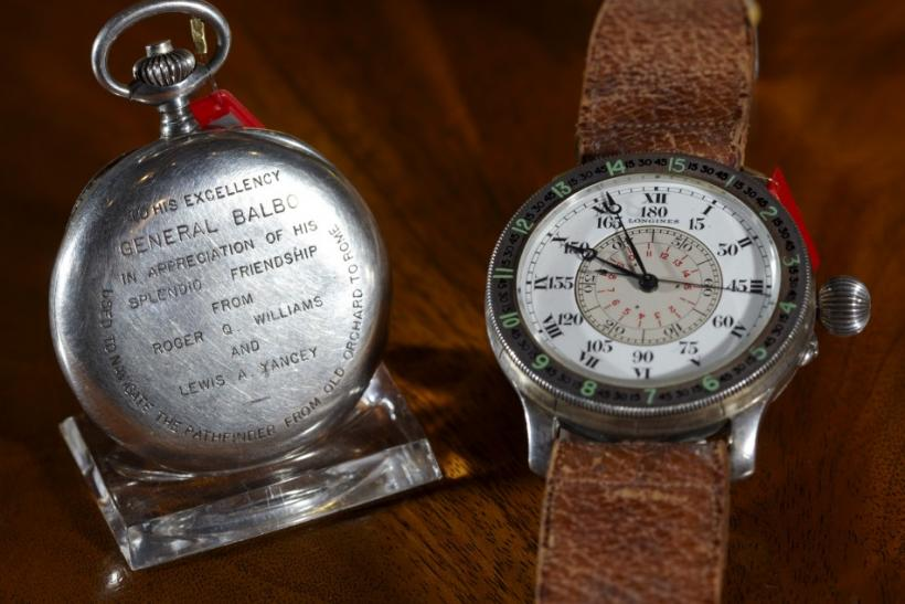 A silver Longines chronograph watch and an oversized silver hour angle aviator's wristwatch during an auction at Christie's in Geneva