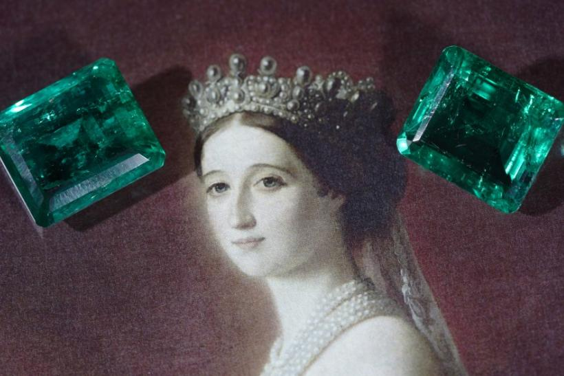 Two unmounted emeralds weighing 17.97 and 15.99 carats are pictured during an auction preview at Christie's in Geneva
