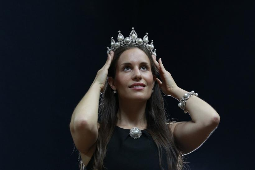 A Christie's employee models The Rosebery pearl and diamond tiara, bracelet and brooch at Christie's in London