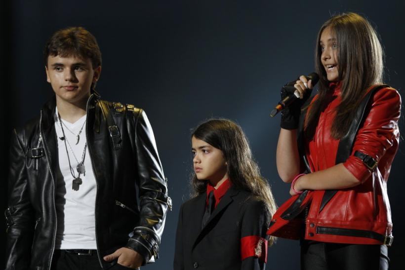 """The children of late singer Michael Jackson, Prince Michael Joseph Jackson Jr., Prince Michael Jackson II (Blanket) and Paris-Michael Katherine Jackson (L-R) stand on stage during the """"Michael Forever"""" tribute concert, which honours late pop ico"""