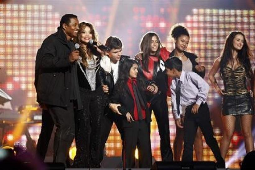 LaToya Jackson (2nd L), sister of the late pop star Michael Jackson, his children Prince Michael Joseph Jackson Jr. (3rd L), Prince Michael Jackson II (Blanket) and Paris-Michael Katherine Jackson (3rd R) perform on stage during the ''Michael Fo