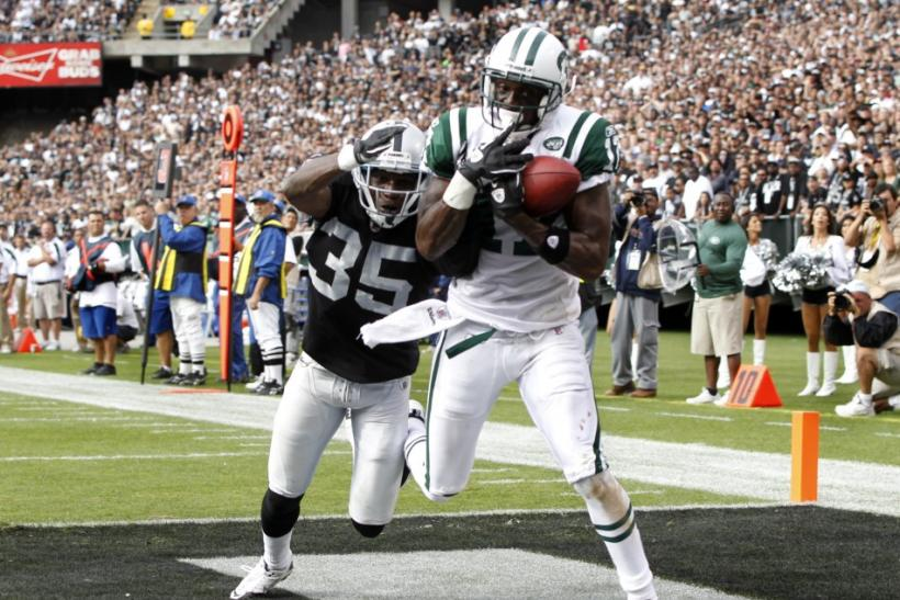 Burress scores a touchdown during the fourth quarter of their NFL football game in Oakland