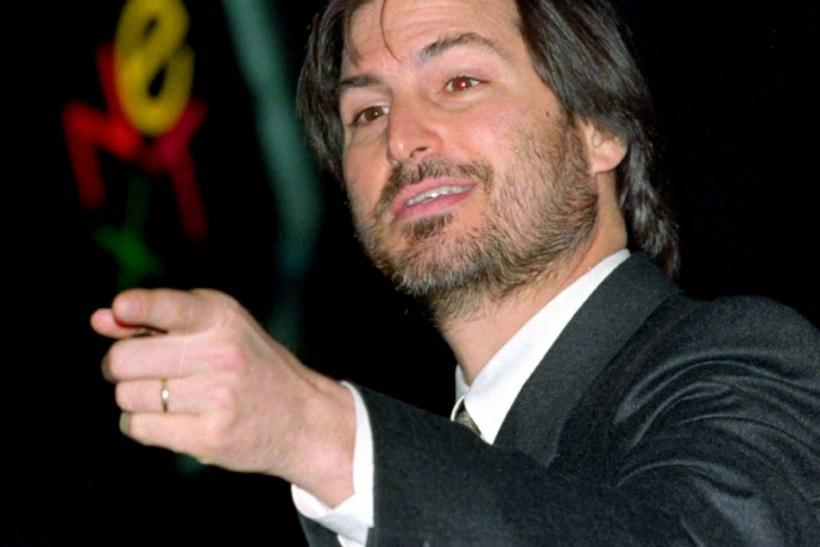 File photo of Apple Inc CEO Steve Jobs waving at the conclusion of the launch of the iPad 2 on stage during an Apple event in San Francisco