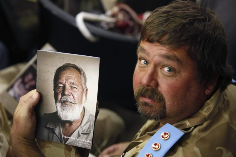 A supporter of white supremacist leader Eugene Terre'blanche holds his picture during his funeral in Ventersdorp