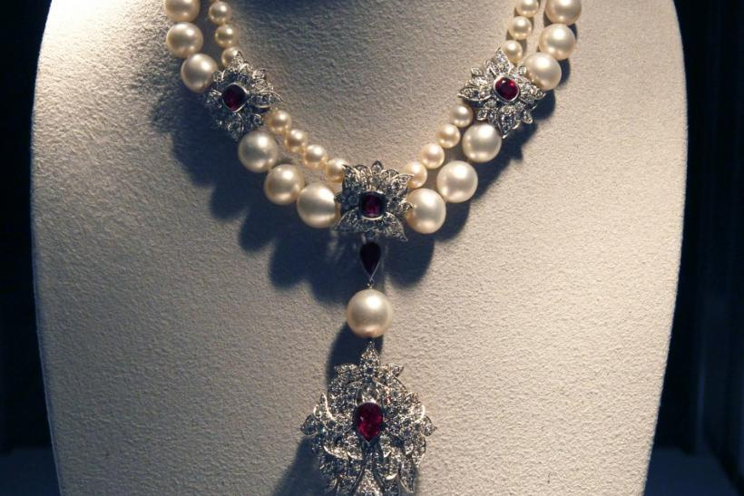 A ruby, diamond and pearl necklace by Cartier with the La Peregrina 60-carat natural pearl pendant is pictured at the press preview for Christie's auction of The Collection of Elizabeth Taylor featuring her jewelry, haute couture, fashion, and fine arts a