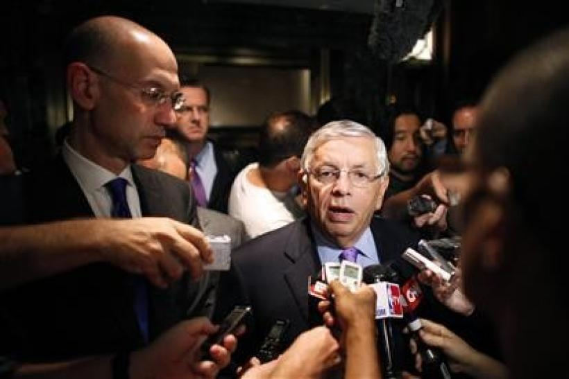 National Basketball Association commissioner David Stern (R) answers questions with deputy commissioner, Adam Silver to members of the media outside the Louvell hotel in New York