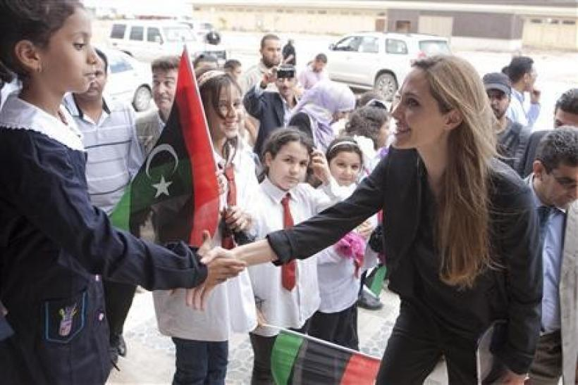 Actress and U.N. goodwill ambassador Angelina Jolie (R) greets a girl during a visit to Misrata