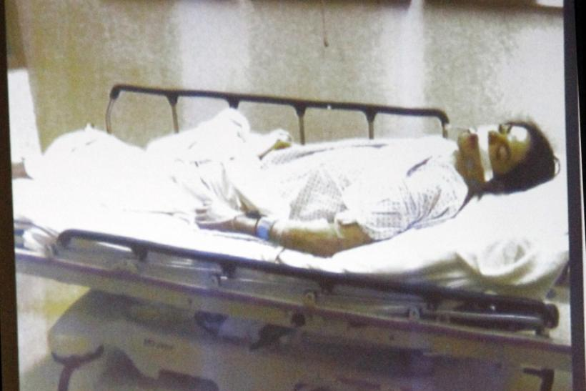 Pop star Michael Jackson lies dead on a gurney in this evidence photo projection at Dr. Conrad Murray's trial in Jackson's death in Los Angeles