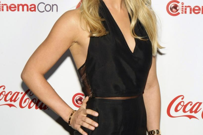 Julianne Hough, CinemaCon Female Rising Star of 2011, poses during CinemaCon, the official convention of the National Association of Theatre Owners, in Las Vegas