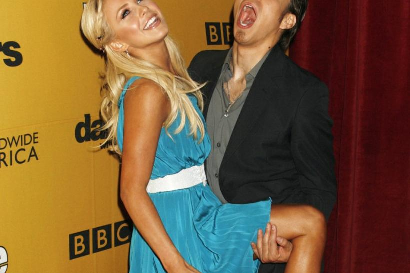 "Former contestant Apolo Anton Ohno (R) and professional dancing partner Julianne Hough pose at the ""Dancing with the Stars"" 100th show party in Hollywood, California"