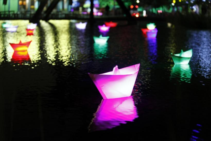 Illuminated boats float in a pond near Potsdamer Platz during the Festival of Lights in Berlin
