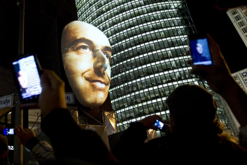 "People take pictures of ""Faces of Berlin"" light installation during the Festival of Lights in Berlin"