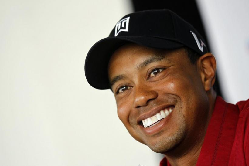 Tiger Woods answers questions at a news conference ahead of the 2011 Chevron World Challenge golf tournament in Hollywood.