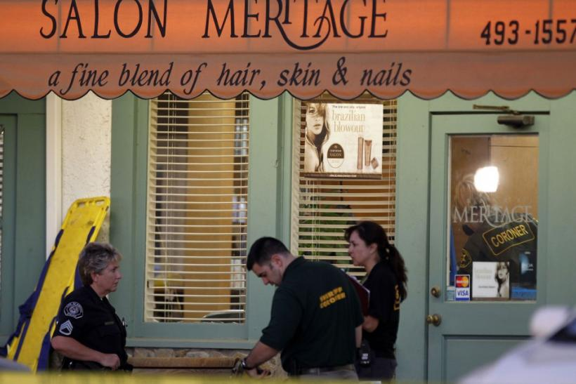 Orange County Coroner and crime scene investigators process bodies for removal from Salon Meritage in Seal Beach