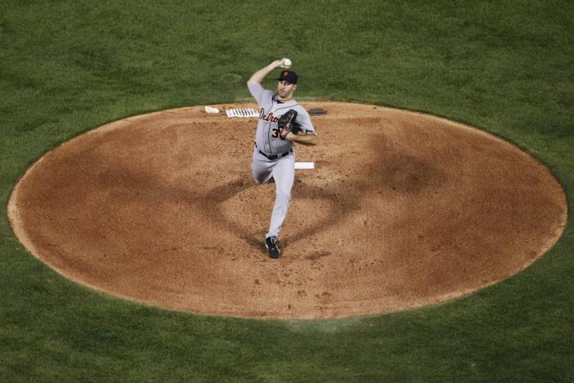 Detroit Tigers pitcher Verlander throws against the Detroit Tigers in the first inning in Game 1 of their MLB American League Championship Series baseball playoffs in Arlington