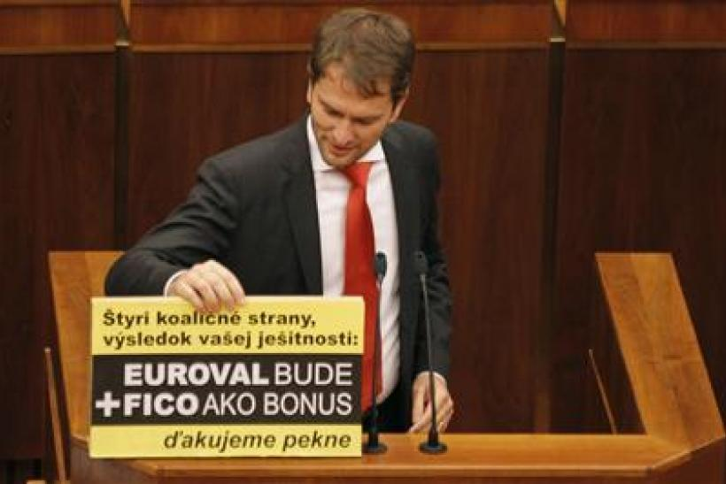 Member of Slovak Parliament Matovic displays a banner during a repeated vote on the euro zone rescue fund, at the Slovak Parliament in Bratislava