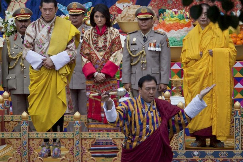 King Jigme Khesar Namgyel Wangchuck (L) and his bride Jetsun Pema take part in a purification ceremony at the Punkaha Dzong during their wedding ceremony in Bhutan's ancient capital Punakha