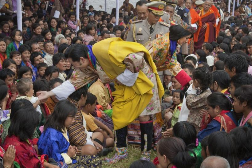 King Jigme Khesar Namgyel Wangchuck and Queen Jetsun Pema greet villagers after their wedding in Bhutan's ancient capital Punakha