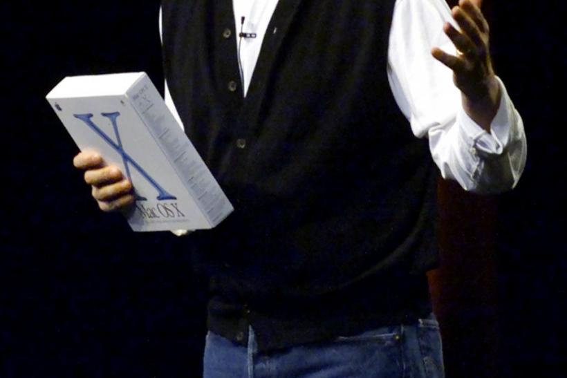 Apple Computer CEO Steve Jobs holds a box containing Apple's new Mac OS X operating system while giving the keynote address at the Apple Worldwide Developers Conference in San Jose, California, May 21, 2001.