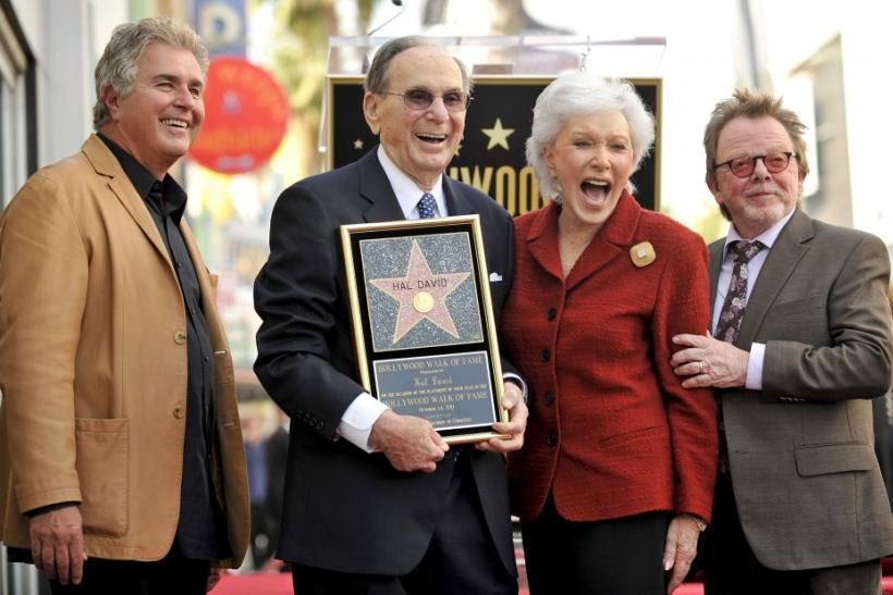 Composer Steve Tyrell (L), Hal David (2nd L), his wife Eunice (2nd R) and actor/singer Paul Williams (R) pose for photographers as the Hollywood Chamber of Commerce honors legendary song writer Hal David with a star on the Hollywood Walk of Fame in Los An